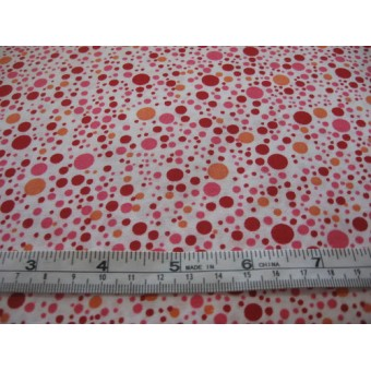red, orange and pink spots on white b/g