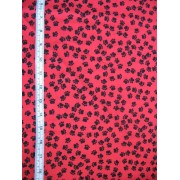 Black paws on red b/g by Timeless Treasures